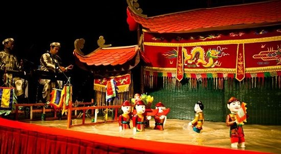 Watch water puppet show is one of the things to do in Hanoi at night