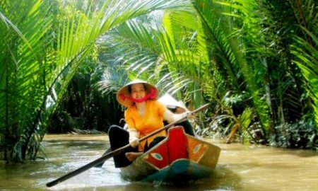 A wooden sampan in the Mekong Delta